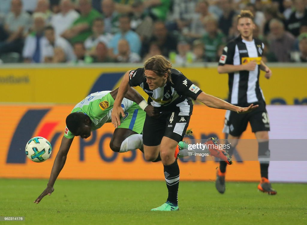 Nany Landry Dimata of Wolfsburg and Jannik Vestergaard of Moenchengladbach battle for the ball during the Bundesliga match between Borussia Moenchengladbach and VfL Wolfsburg at Borussia-Park on April 21, 2018 in Moenchengladbach, Germany.