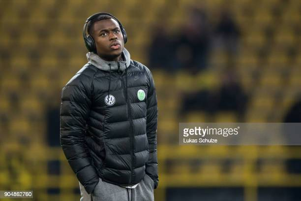Nany Landry Dimata of Wolfsburg is seen with headphones of Bose prior to the Bundesliga match between Borussia Dortmund and VfL Wolfsburg at Signal...