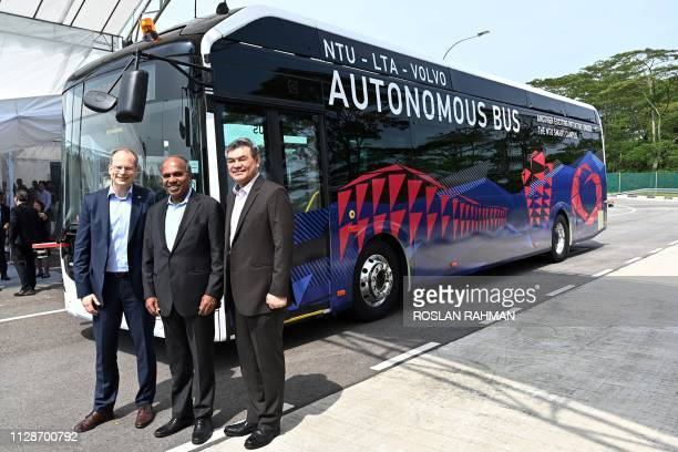 Nanyang Technology University President Subra Suresh Volvo Buses President Hakan Agnevall and Land Transport Authority Chief Innovation and...