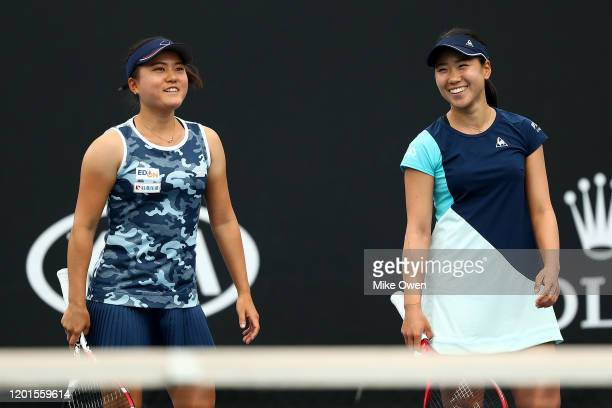 Nao Hibino and Makoto Ninomiya of Japan play in their Women's Doubles first round match against Lucie Hradecka of Czech Republic and Andreja Klepac...