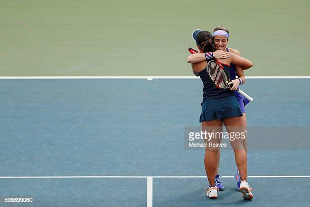 Nao Hibino of Japan and Nicole Gibbs of the United States celebrate their win over Michaella Krajicek of Netherlands and Heather Watson of the United...