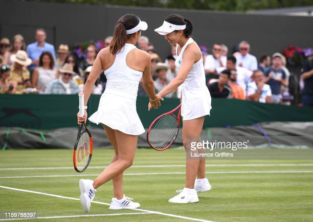 Nao Hibino of Japan and playing partner Miyu Kato of Japan celebrate in their Ladies' Doubles first round match against Anna Blinkova of Russia and...