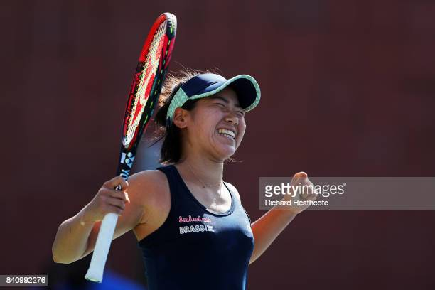 Nao Hibino of Japan celebrates defeating Catherine Bellis of the United States during their first round Women's Singles match on Day Three of the...
