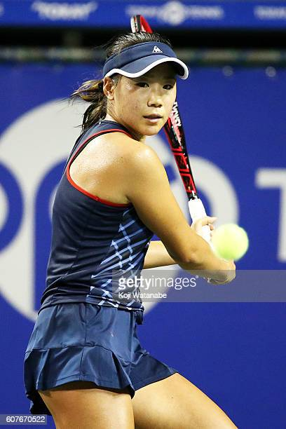 Nao Hibino of Japan competes against Magda Linette of Poland during women's singles match day one of the Toray Pan Pacific Open at Ariake Colosseum...