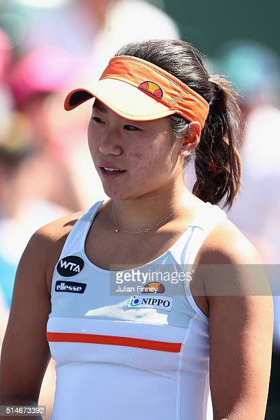 Nao Hibino of Japan looks on in her match against Lauren Davis of USA during day four of the BNP Paribas Open at Indian Wells Tennis Garden on March...