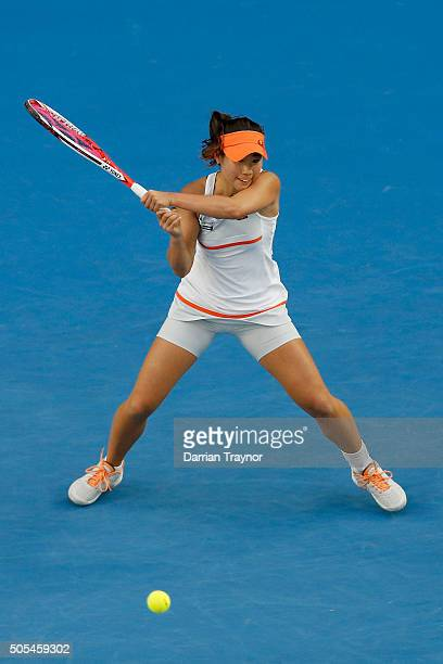 Nao Hibino of Japan plays a back hand in her first round match against Maria Sharapova of Russia during day one of the 2016 Australian Open at...