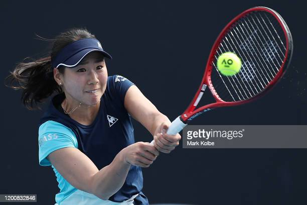 Nao Hibino of Japan plays a backhand during her Women's Singles first round match against Shuai Peng of China on day two of the 2020 Australian Open...