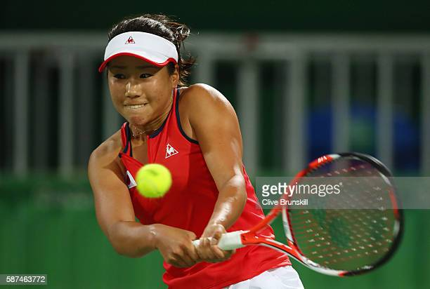 Nao Hibino of Japan plays a backhand during the Women's Singles second round match against Garbine Muguruza of Spain on Day 3 of the Rio 2016 Olympic...