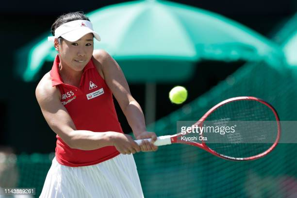 Nao Hibino of Japan plays a backhand in her singles match against Bibiane Schoofs of the Netherlands on day one of the Fed Cup World Group II Playoff...
