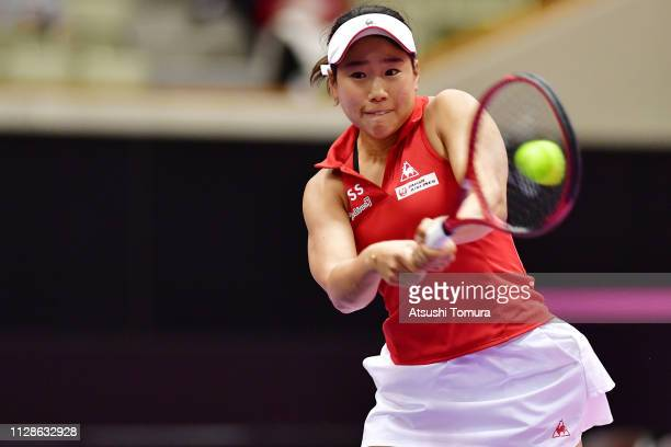 Nao Hibino of Japan plays a backhand in her Women's Singles match against Georgina GarciaPerez of Spain on day two of the Fed Cup World Group II...
