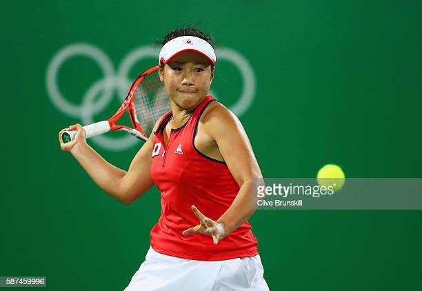 Nao Hibino of Japan plays a forehand during the Women's Singles second round match against Garbine Muguruza of Spain on Day 3 of the Rio 2016 Olympic...