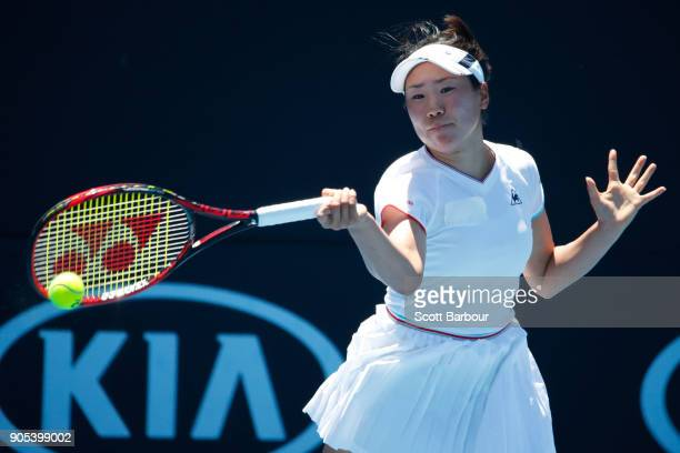 Nao Hibino of Japan plays a forehand in her first round match against Donna Vekic of Croatia on day two of the 2018 Australian Open at Melbourne Park...