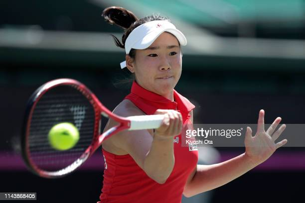Nao Hibino of Japan plays a forehand in her singles match against Bibiane Schoofs of the Netherlands on day one of the Fed Cup World Group II Playoff...