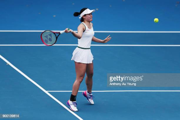Nao Hibino of Japan plays a shot in her first round match against SuWei Hsieh of Taiwan during day one of the ASB Women's Classic at ASB Tennis...