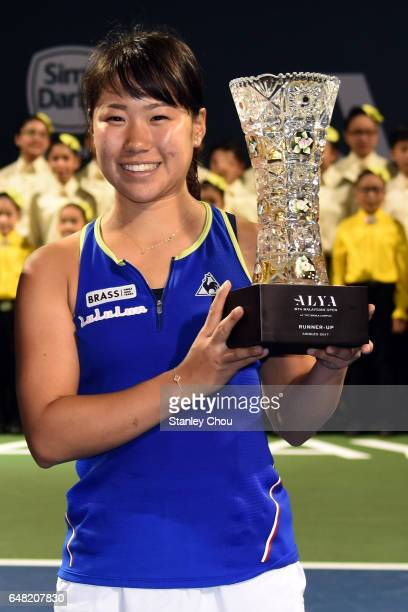 Nao Hibino of Japan poses with the WTA Malaysian Open Runner Up Trophy during the Final of the 2017 WTA Malaysian Open at the TPC on March 5 2017 in...