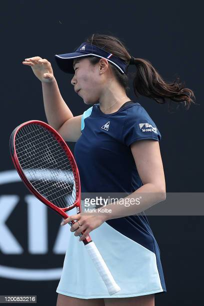 Nao Hibino of Japan reacts during her Women's Singles first round match against Shuai Peng of China on day two of the 2020 Australian Open at...
