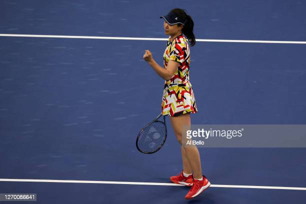 Nao Hibino of Japan reacts during her Women's Singles first round match against Garbiñe Muguruza of Spain on Day Two of the 2020 US Open at the USTA...