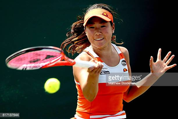 Nao Hibino of Japan returns a shot to Julia Goerges of Germany during the Miami Open presented by Itau at Crandon Park Tennis Center on March 23 2016...