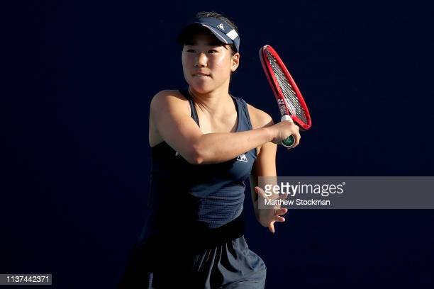 Nao Hibino of japan returns a shot to Karolina Muchova of Czech Republic during the Miami Open Presented by Itau at Hard Rock Stadium March 21 2019...