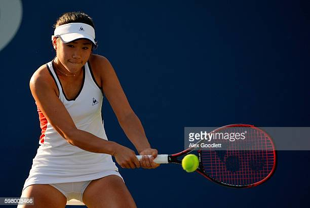 Nao Hibino of Japan returns a shot to Kristina Mladenovic of France during her first round Women's Singles match on Day Two of the 2016 US Open at...
