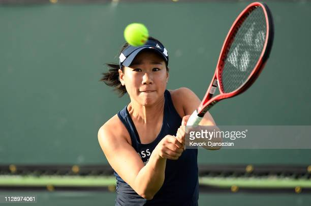 Nao Hibino of Japan returns against Jennifer Brady of the United States during their ladies singles first round match on day three of the BNP Paribas...