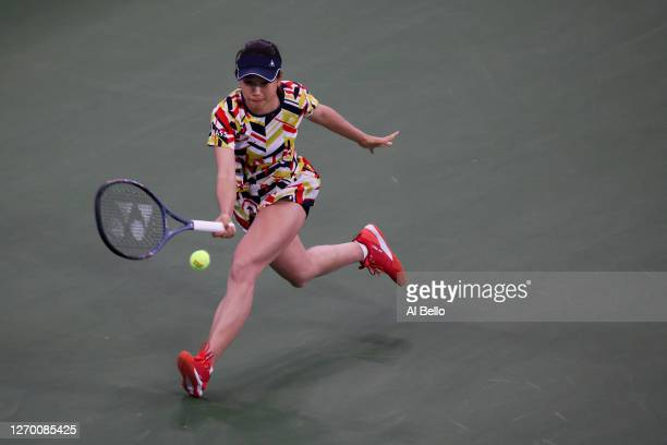 Nao Hibino of Japan returns the ball during her Women's Singles first round match against Garbiñe Muguruza of Spain on Day Two of the 2020 US Open at...