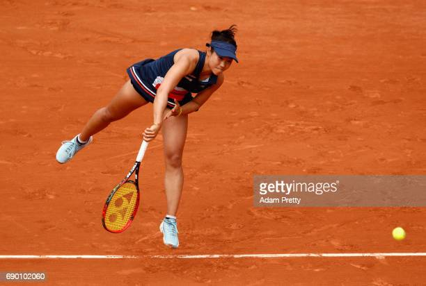 Nao Hibino of Japan serves during the ladies singles first round match against Carolina Garcia of France on day three of the 2017 French Open at...