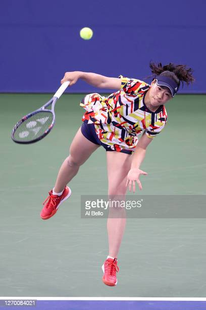 Nao Hibino of Japan serves the ball during her Women's Singles first round match against Garbiñe Muguruza of Spain on Day Two of the 2020 US Open at...