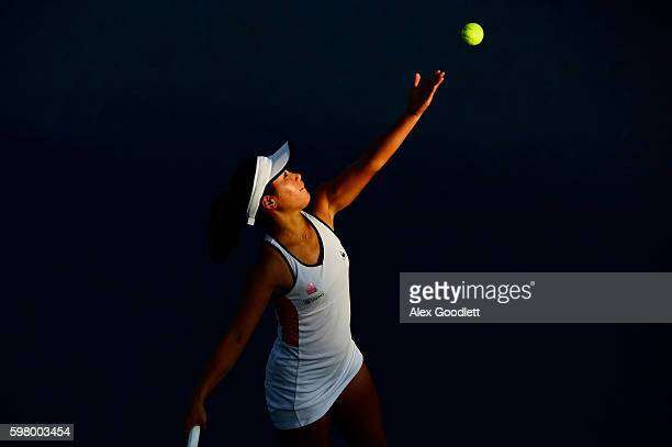 Nao Hibino of Japan serves to Kristina Mladenovic of France during her first round Women's Singles match on Day Two of the 2016 US Open at the USTA...
