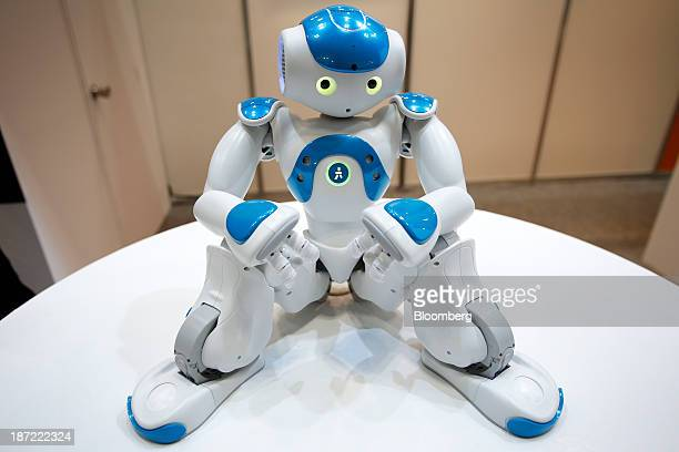 Nao humanoid robot, developed by Aldebaran Robotics, sits on display at the International Robot Exhibition 2013 in Tokyo, Japan, on Wednesday, Nov....