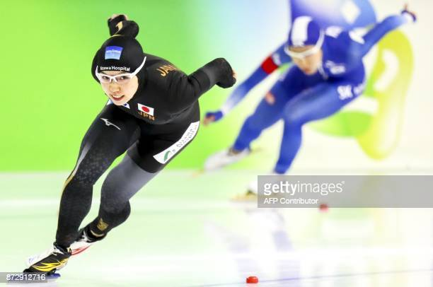 Nao Kodaira from Japan and SangHwa Lee from South Korea compete during the Women's 500 meter race of the ISU Speed Skating World Cup at Thialf Ice...