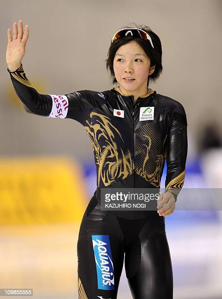 Nao Kodaira Japan waves to cheering fanes after finishing the women's 1000m division A at the World Cup Speed Skating competition in Obihiro northern...