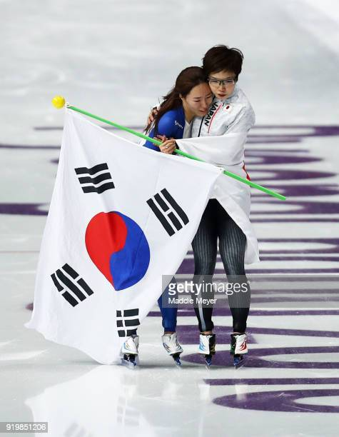 Nao Kodaira of Japan and SangHwa Lee of Korea celebrate after winning the gold and silver medal respectively during the Ladies' 500m Individual Speed...