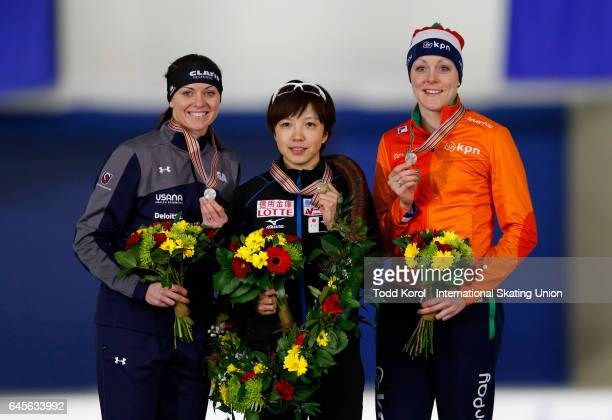 Nao Kodaira of Japan celebrates winning the overall women's points title with Heather Bergsma of the United States who came in second and Jorien ter...