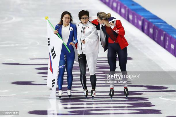 Nao Kodaira of Japan SangHwa Lee of Korea and Karolina Erbanova of the Czech Republic celebrate after winning medals during the Ladies' 500m...