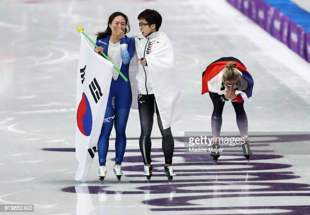 Nao Kodaira of Japan SangHwa Lee of Korea and Karolina Erbanova of the Czech Republic celebrate after winning medals during the Ladies' 500m...