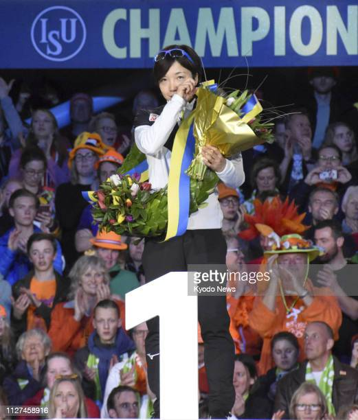 Nao Kodaira of Japan sheds tears on the podium after winning the women's overall title at the ISU World Sprint Speed Skating Championships in...
