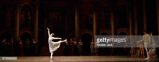 Nao Sakuma as Juliet and Yasuo Atsuji as Romeo with artists of the company in Birmingham Royal Ballet's production of Kenneth MacMillan's Romeo and...