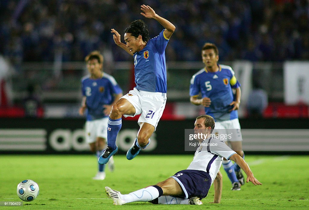 Naohiro Ishikawa of Japan and Steven Whittaker of Scotland compete for the ball during Kirin Challenge Cup 2009 match between Japan and Scotland at Nissan Stadium on October 10, 2009 in Yokohama, Japan.