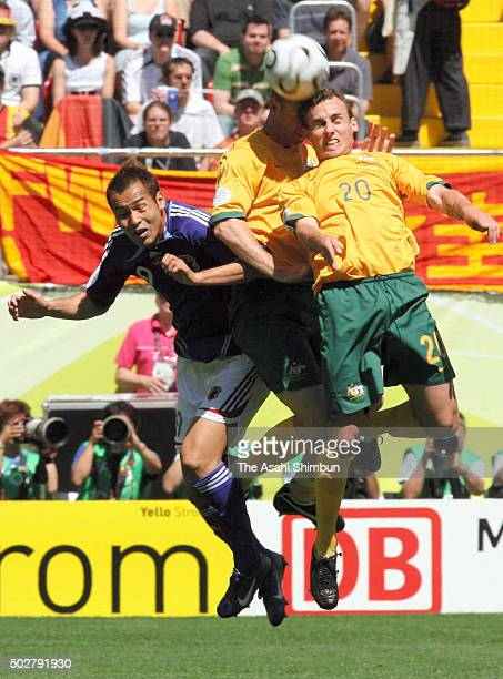 Naohiro Takahara of Japan and Luke Wilkshire of Australia compete for the ball during the FIFA World Cup Germany 2006 Group F match between Australia...