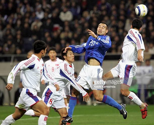 Naohiro Takahara of Japan battles for the ball during the 2006 FIFA World Cup Asian qualifying match between Japan and North Korea at Saitama Stadium...