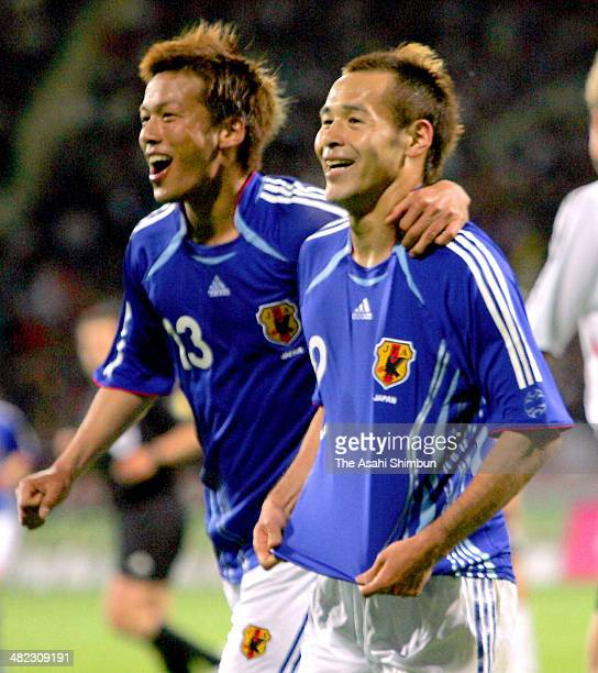 Naohiro Takahara of Japan celebrates scoring his team's first goal with his teammate Atsushi Yanagisawa during the international friendly match...