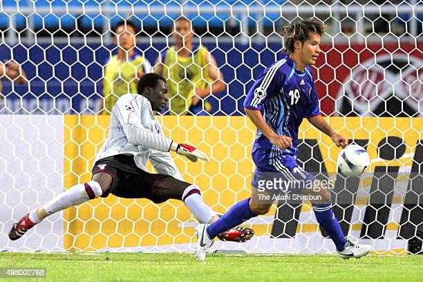 Naohiro Takahara of Japan celebrates scoring his team's first goal during the AFC Asian Cup Group B match between Japan and Qatar at My Dinh National...