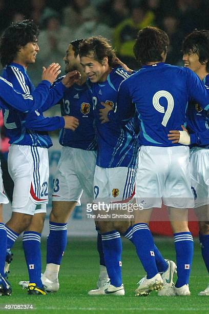 Naohiro Takahara of Japan celebrates scoring his team's second goal with his team mates during the international friendly match between Japan and...