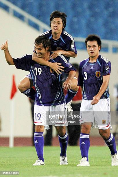 Naohiro Takahara of Japan celebrates scoring his team's second goal with his team mate Yasuhito Endo during the AFC Asian Cup Group B match between...