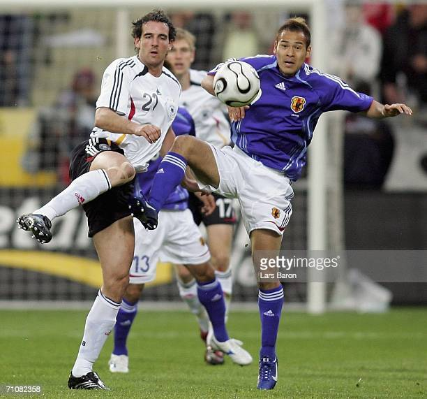 Naohiro Takahara of Japan in action with Christoph Metzelder of Germany during the international friendly match between Germany and Japan at the...