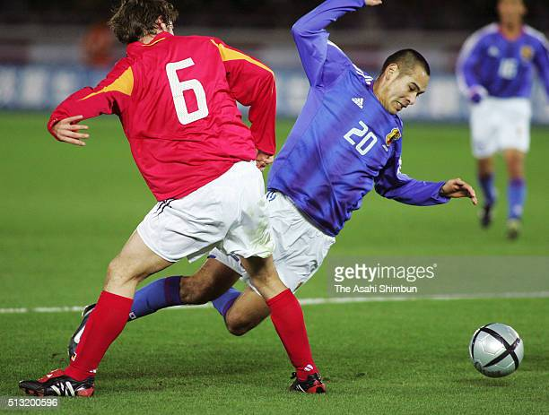 Naohiro Takahara of Japan is tackled by Christian Schulz of Germany during the international friendly match between Japan and Germany at the...