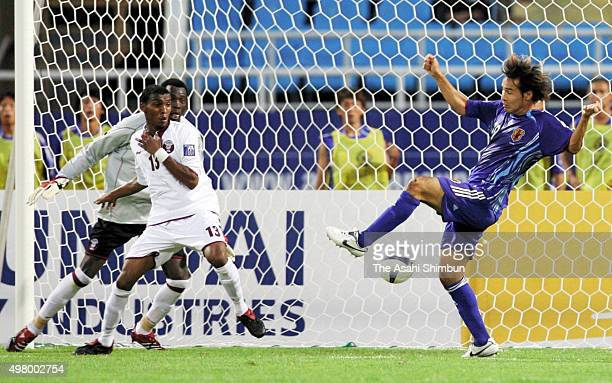 Naohiro Takahara of Japan scores his team's first goal during the AFC Asian Cup Group B match between Japan and Qatar at My Dinh National Stadium on...