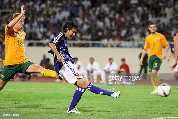 Naohiro Takahara of Japan scores his team's first goal during the AFC Asian Cup quarter final match between Japan and Australia at My Dinh National...