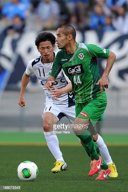 Naohiro Takahara of Tokyo Verdy and Kazuyoshi Miura of Yokohama FC compete for the ball during JLeague second division match between Tokyo Verdy and...